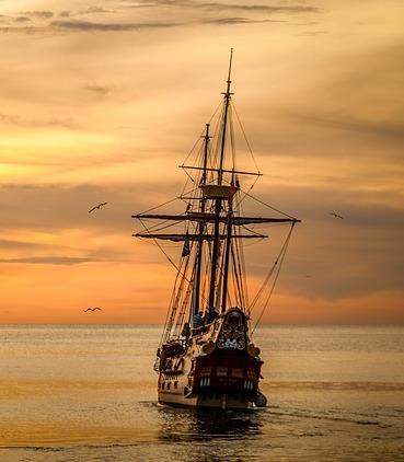 Sailing ship in sunset scene